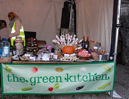 table with green kitchen banner